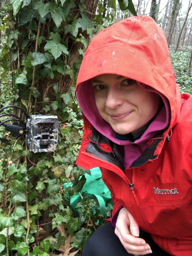 wildlife biologist with camera trap