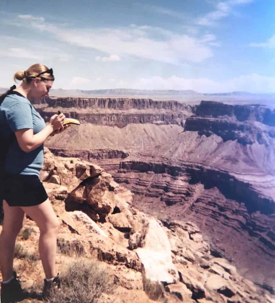 wildlife biologist using a GPS