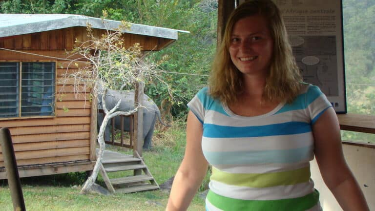 Me with Billy in the background. He was only one of two elephants that would visit the field station during the day.